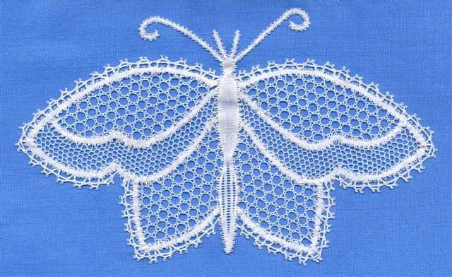 lace butterfly mounted on pale blue fabric